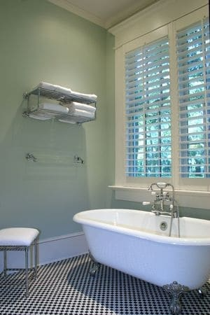 Beautiful bathroom with an old style footed tub and new pipes